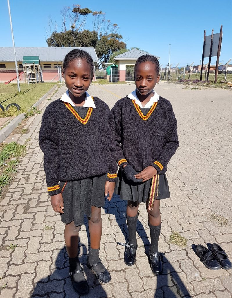 Bernie and Vuyo delivered hand-knitted jerseys and new school shoes to these young ladies